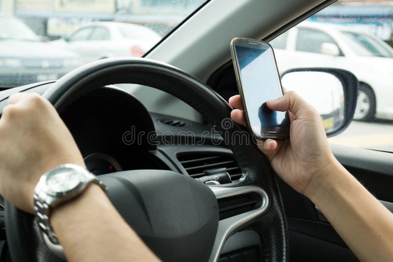 Texting Podczas gdy Jadący fotografia stock