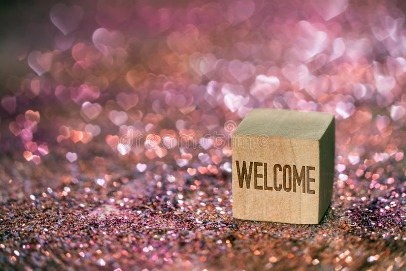 Texto bem-vindo com luz do bokeh do coração foto de stock royalty free
