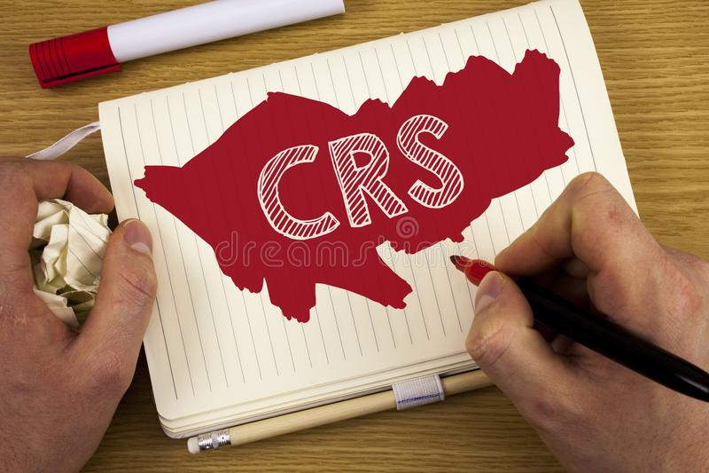 Texto CRS de la escritura de la palabra Concepto del negocio para el estándar común de la información para compartir la informaci fotografía de archivo libre de regalías