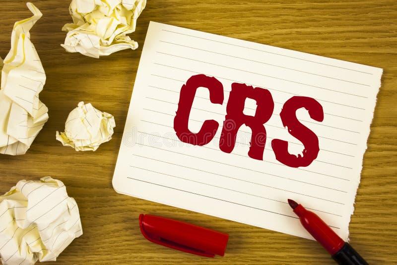 Texto CRS de la escritura de la palabra Concepto del negocio para el estándar común de la información para compartir la informaci imagen de archivo libre de regalías