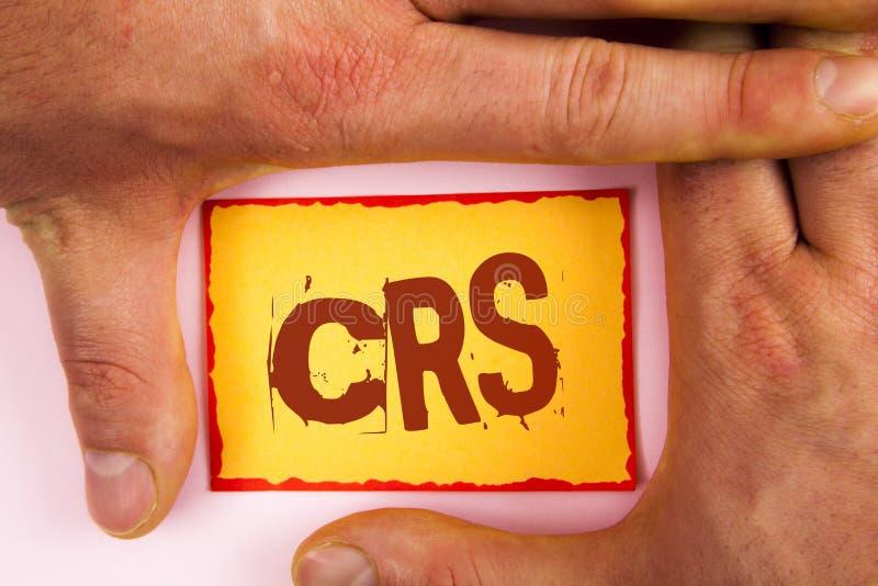 Texto CRS de la escritura de la palabra Concepto del negocio para el estándar común de la información para compartir la informaci fotografía de archivo