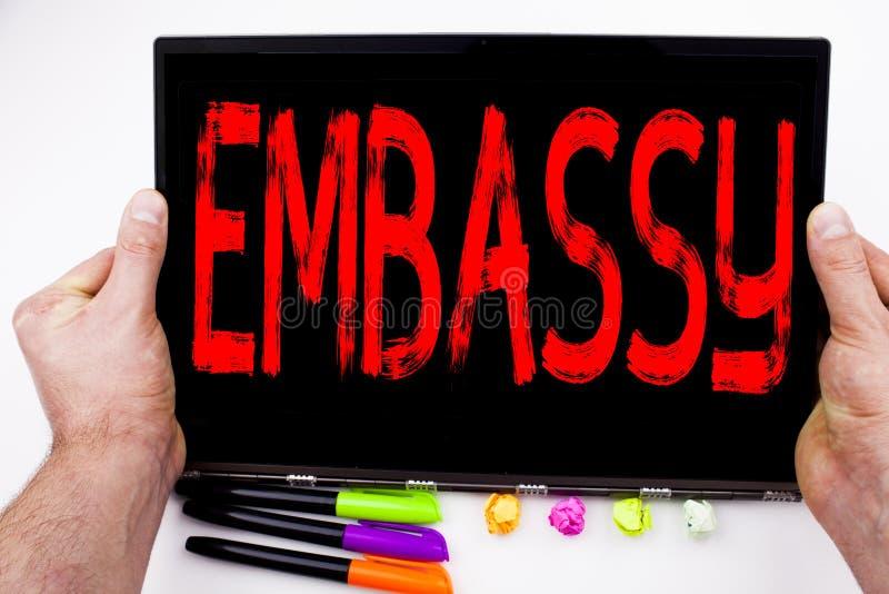 Texto da embaixada escrito na tabuleta, computador no escritório com marcador, pena, artigos de papelaria Conceito do negócio par imagem de stock royalty free
