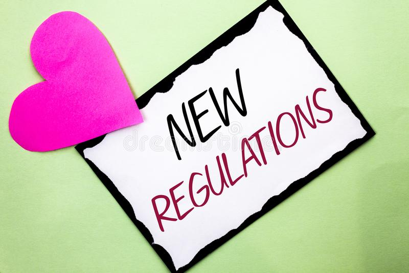 Texto da escrita que escreve regulamentos novos A mudança do significado do conceito das leis ordena as especificações de padrões imagem de stock