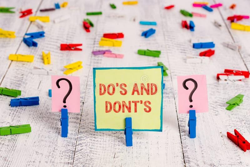 Texto de escritura a mano Do S And Dont S. Concepto: Normas o costumbres relativas a algunas actividades o acciones imagenes de archivo