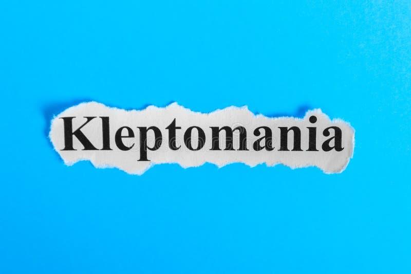 Texto de la cleptomanía en el papel Cleptomanía de la palabra en un trozo de papel Imagen del concepto Síndrome de la cleptomanía foto de archivo libre de regalías