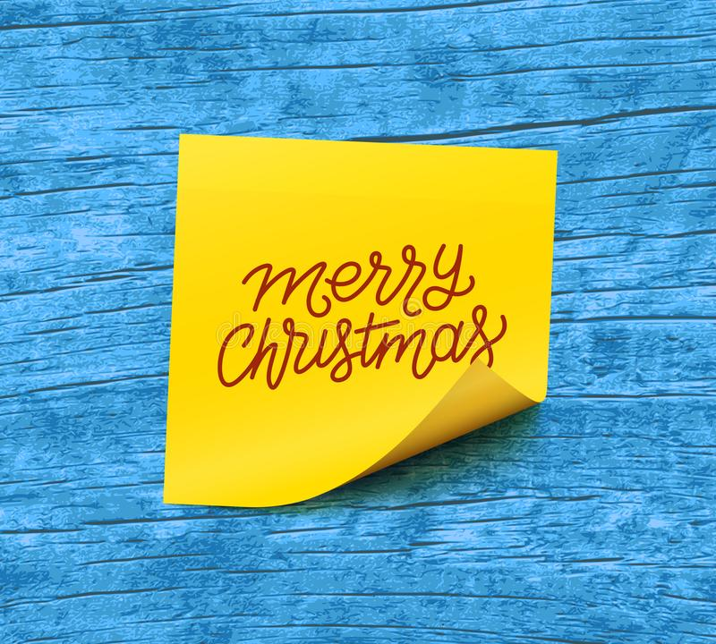 Texto de la Feliz Navidad en el papel de nota pegajoso amarillo stock de ilustración