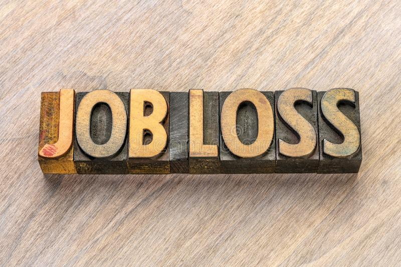 Texto de la pérdida de trabajo en el tipo de madera fotografía de archivo