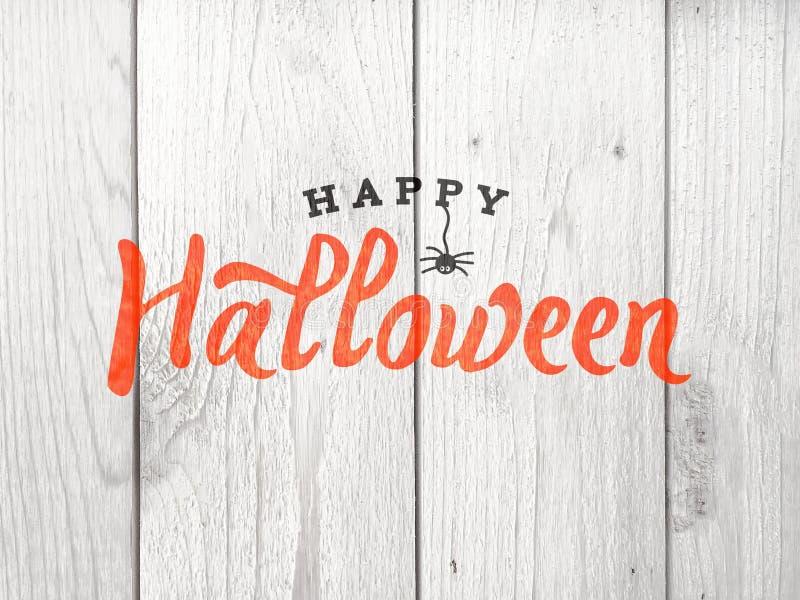 Texto del feliz Halloween sobre fondo de madera apenado fotos de archivo