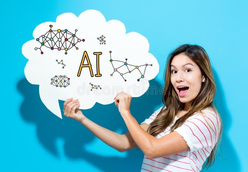 Texto do AI com a jovem mulher que guarda uma bolha do discurso foto de stock