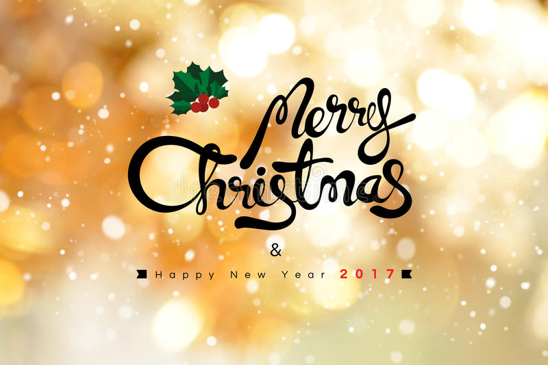 Texto do Feliz Natal e do ano novo feliz 2017 no bokeh brilhante do ouro foto de stock