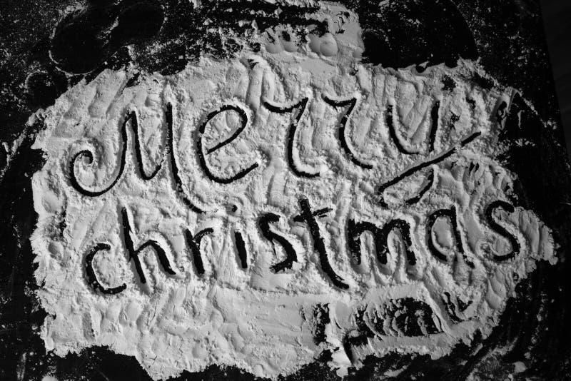 Texto do Feliz Natal escrito na farinha fotografia de stock