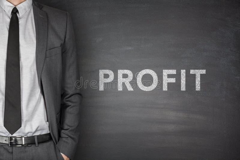 Texto do lucro no quadro-negro foto de stock royalty free