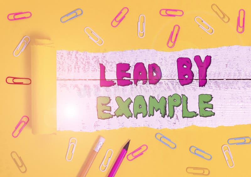 Texto escrito en Word Lead By Ejemplo Concepto de negocio para ser un líder mentor seguir las reglas dar ejemplos de Coach imagenes de archivo
