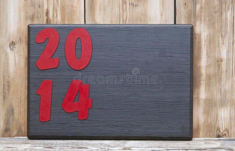 Texto 2014 na placa de madeira fotografia de stock royalty free