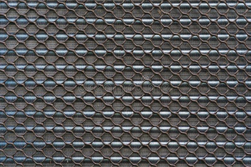 Textrue av den gamla kyla aluminiumfenapanelen av luftkompressorn eller royaltyfri foto