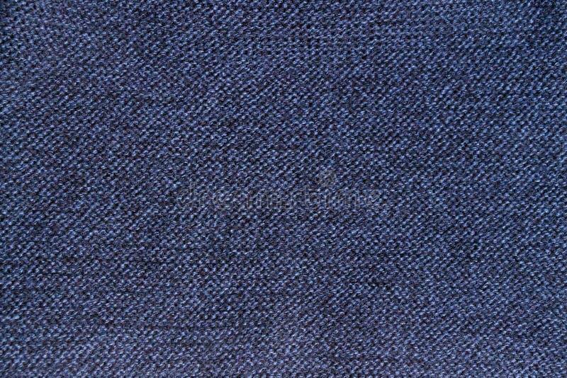 Textur aus blauem Gewirken aus Wolle oder aus Gewirken lizenzfreie stockfotos