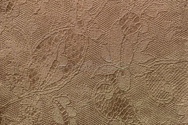 Textur av ?ktt l?der f?r fragment med en abstrakt n?rbild f?r blom- prydnad Guld- tappning brons f?rg f?r royaltyfria bilder