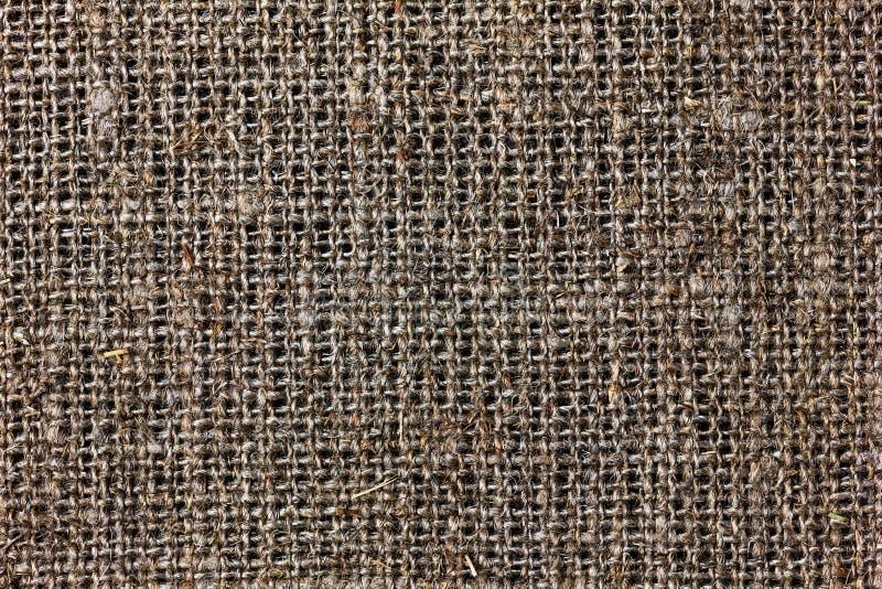 Textur av att plundra eller hessians- eller säckvävmaterial, säckvävsäck arkivfoton