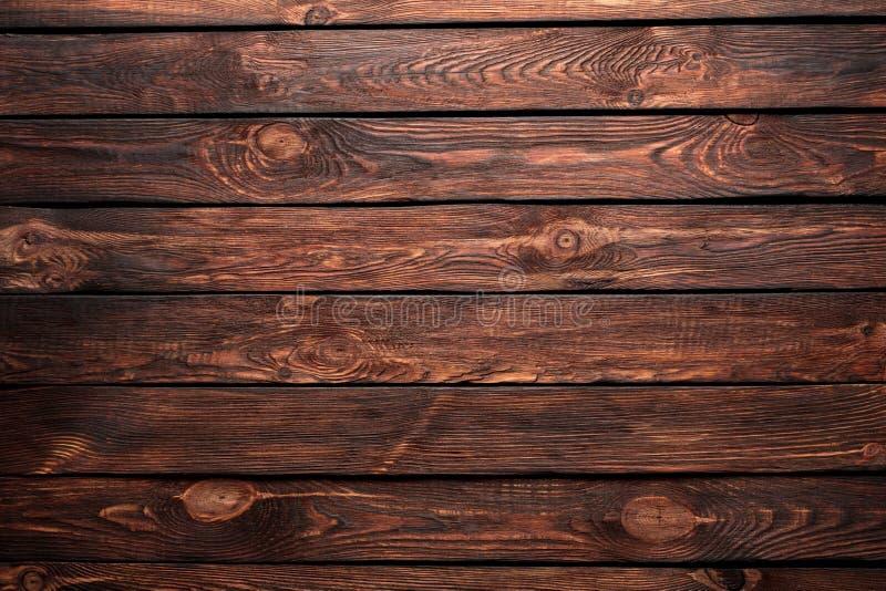 Textur av bräden av mörkt gammalt brunt trä royaltyfria bilder