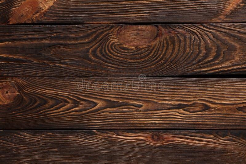 Textur av bräden av mörkt gammalt brunt trä vektor illustrationer