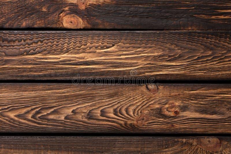 Textur av bräden av mörkt gammalt brunt trä arkivbilder