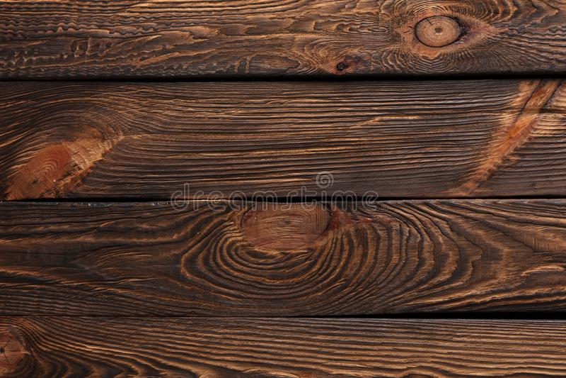Textur av bräden av mörkt gammalt brunt trä fotografering för bildbyråer