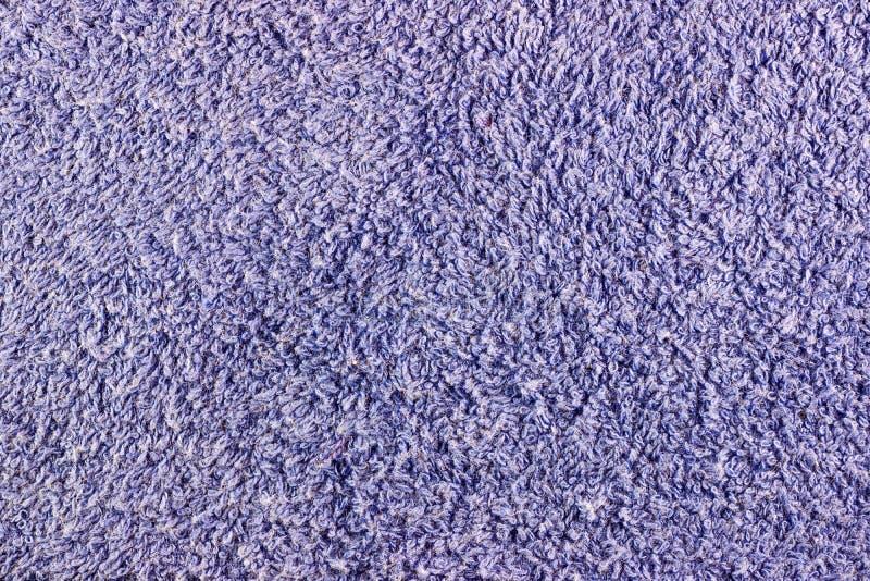 Textur av den blåa closeupen för frottétorkduk Bakgrund för naturligt tyg royaltyfri fotografi