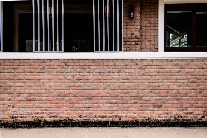 Textur av den dekorativa modellen för staket för vägg för röd tegelsten arkivfoton