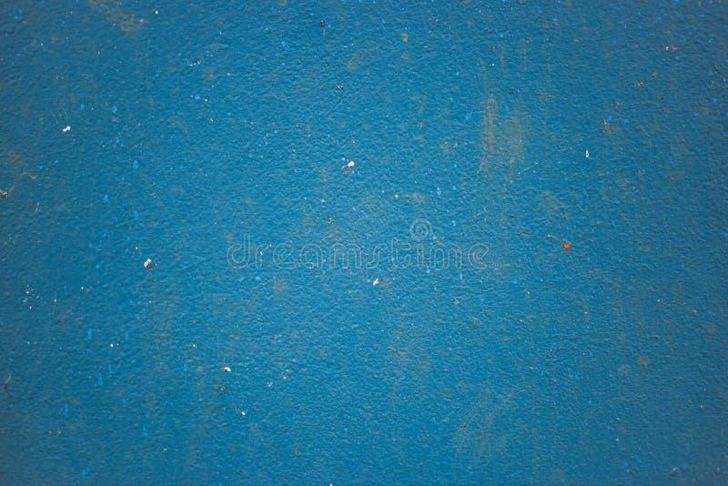 Textur av den gamla smutsiga blåa väggen royaltyfria foton