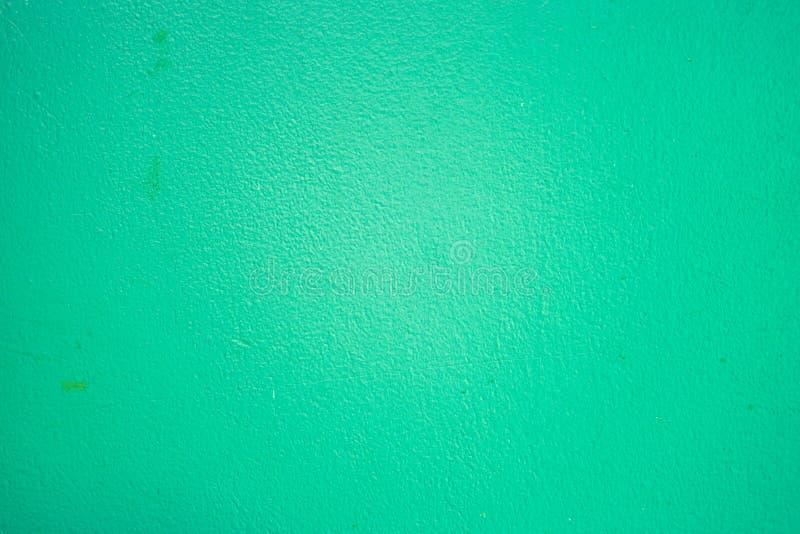 Textur av den gamla smutsiga gröna väggen arkivfoto