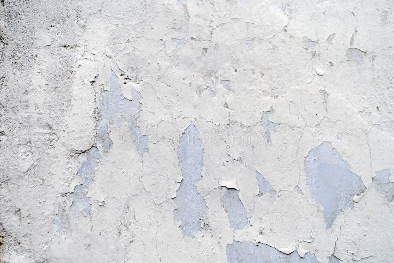 Textur av den gamla tappningväggen med sprucken målarfärg arkivbild