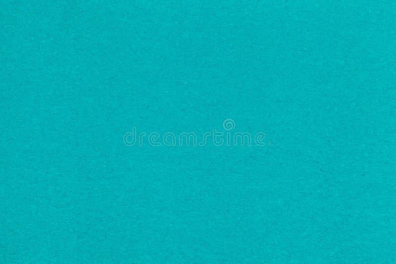 Textur av den gamla turkospapperscloseupen Struktur av en tät papp Den blåa bakgrunden royaltyfri bild