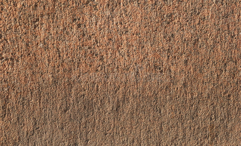 Textur av den gamla väggen av rosa granit royaltyfria bilder