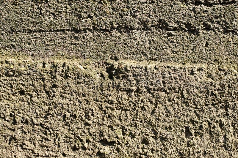 Textur av den gråa ojämna betongväggen Kan användas som en vykort royaltyfria bilder