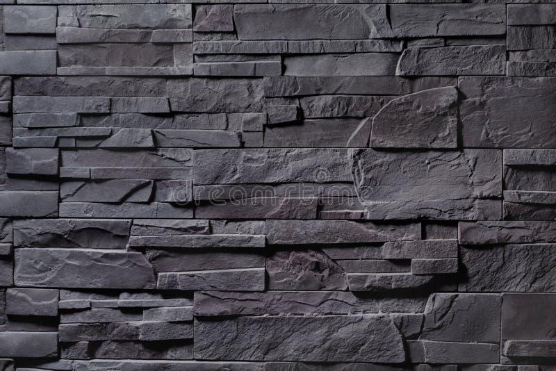 Textur av den gråa stenväggen royaltyfria bilder