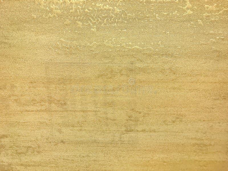 Textur av den guld- tapeten med en modell Gul pappers- yttersida, strukturcloseup arkivfoto