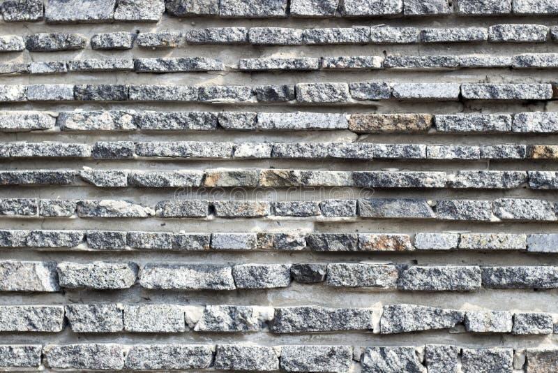 Textur av den naturliga stenen fodrade Bakgrund f?r formgivare royaltyfria foton