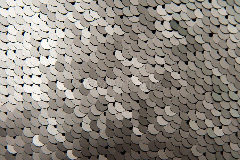 Textur av den skinande paljettnärbilden för silver arkivbild