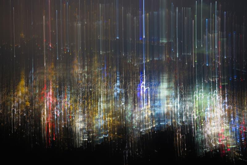Textur av den suddiga nattstaden abstrakt foto av färgrik bokeh och ljus av nattstaden royaltyfri foto