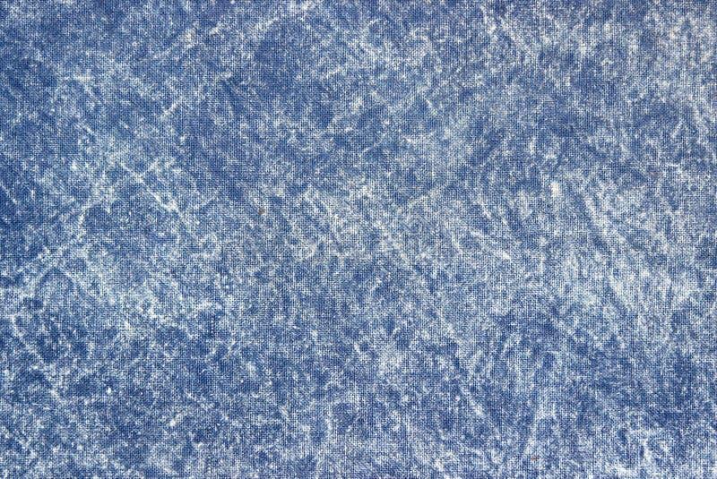 Textur av ett blått sten-tvättat grov bomullstvilltyg royaltyfria foton