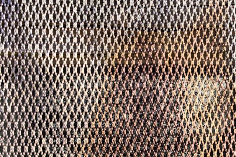 Textur av ett gammalt rostigt ingrepp arkivbild