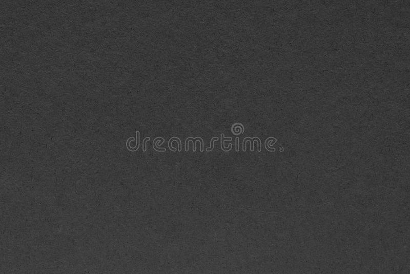 Textur av ett papp- eller pappersmaterial av svart färg arkivbild