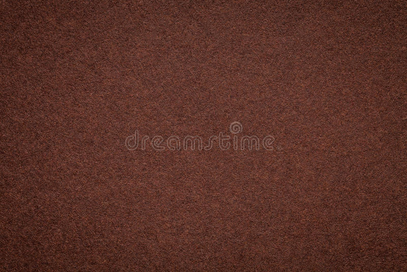 Textur av gammal mörk bakgrund för brunt papper, closeup Struktur av tät umbrafärgad papp fotografering för bildbyråer