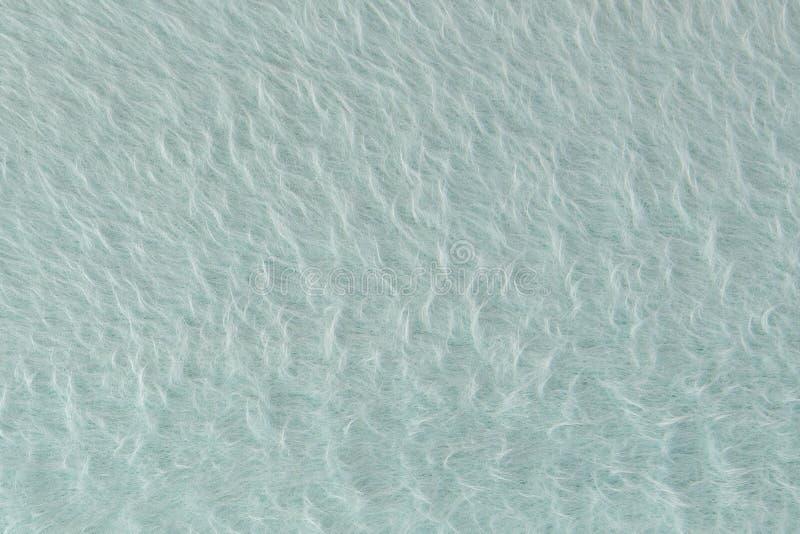 Textur av grå ull för garn Gr? f?rg-gr?splan abstrakt bakgrund Grå färgull för felting royaltyfria bilder