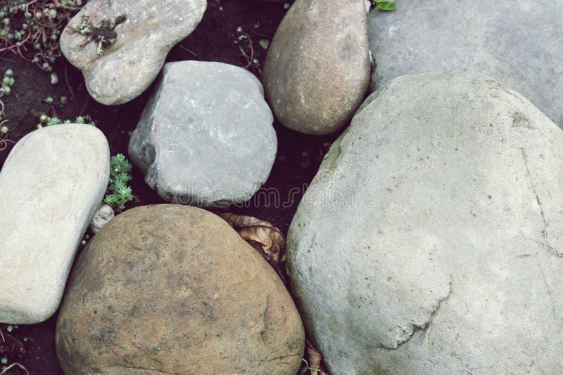 Textur av gråa stora havsstenar arkivfoto