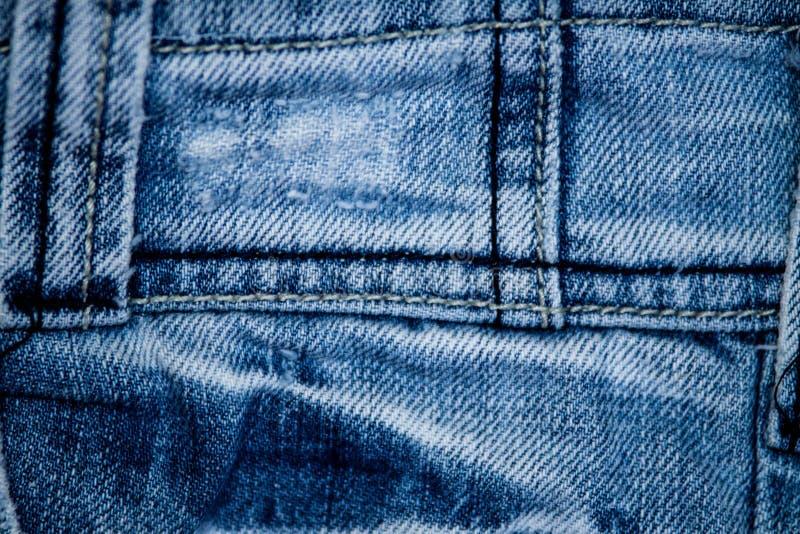 Textur av jeanstextilslutet upp arkivfoto