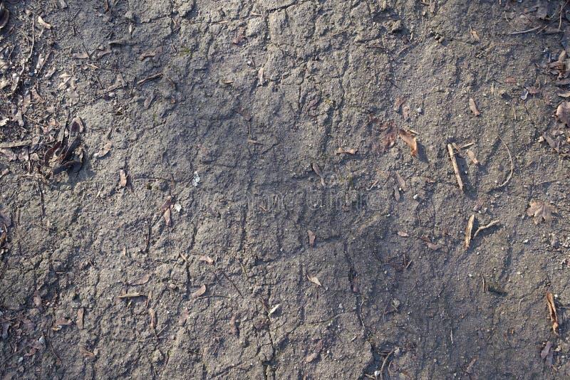 Textur av mörk grå yttersida av grusvägen arkivfoton