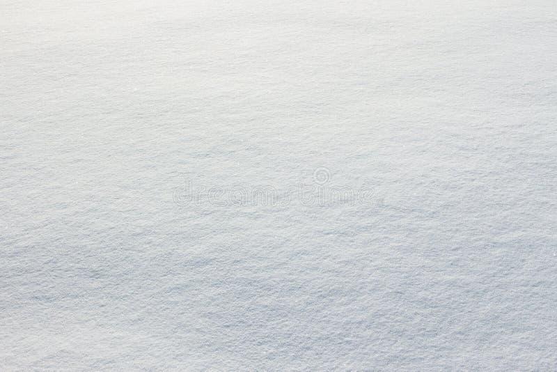Textur av ny snöbeläggningjordning arkivbild