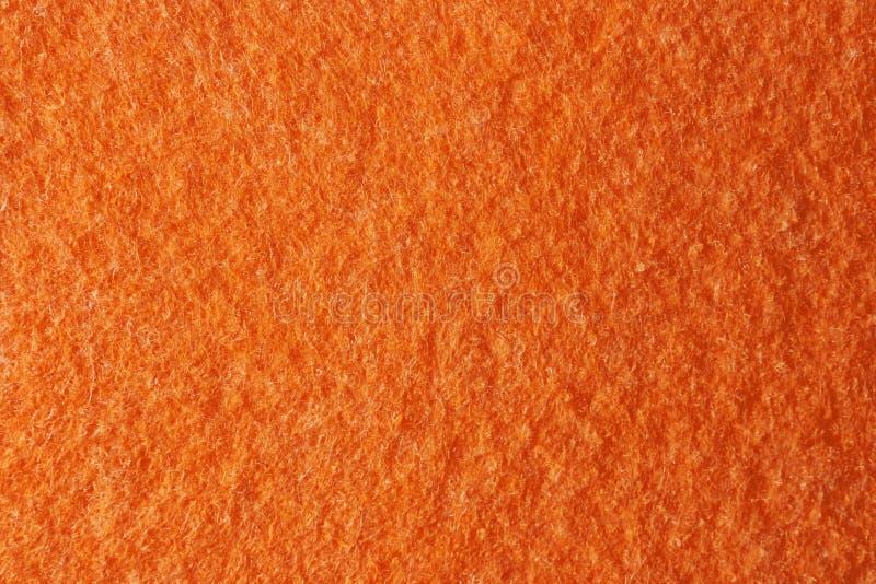 Textur av orange filt som bakgrund arkivbilder