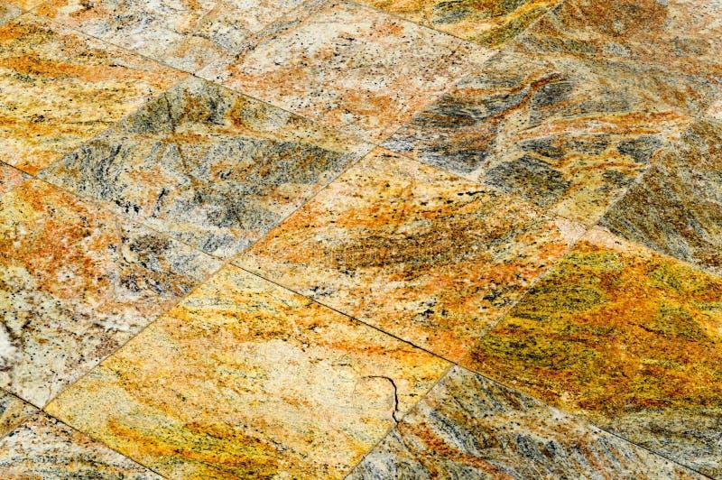 Textur av romber som göras av för keramisk härliga dyra tegelplattor granitbrunt för sten grönska för abstraktionbakgrundsgentile royaltyfri fotografi